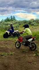 Grandsons (Ntvgypsylady) Tags: grandsons quad dirtbike riding mountain badgermountain trees bushes grass weeds sky clouds bluesky helmets boys fun dirt trailriding dirtroads woods