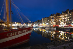 "the Vieux Bassin (Old Harbour) at night. Honfleur, Calvados, Normandie (Normandy), France (grumpybaldprof) Tags: ""vieuxbassin"" ""oldharbour"" honfleur calvados normandie normandy france ""quaistecatherine"" ""quaiquarantaine"" quai ""quaistetienne"" ""stecatherine"" ""lalieutenance"" quarantaine water boats sails ships harbour historic old ancient monument picturesque restaurants bars town port colour lights reflection architecture buildings mooring sailing stone collombage halftimbered yachts carousel merrygoround reflections ""waterreflections ""wetreflections"" funfair ""eglisesaintecatherine"" ""églisesaintétienne"" yacht voillier waterfront night dark nocturne gloaming evening ""lowlight"" nuit mood calm peaceful tranquil restful ""longexposure"" ""neutraldensity"" nd ""canon70d"" ""sigma1020mmf456dchsm"" ""wideangle"" ultrawide"
