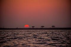 Dramatic Sunset over Massnoua Island breakwater, Abu Dhabi (Bluebullet1) Tags: sunset sun water sea orange blue outside sky light nature landscape colour