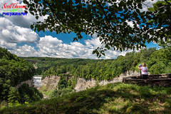 Inspiration Point at Letchworth State Park (Scott Thomas Photography) Tags: castile inspirationpoint letchworthstatepark middlefalls nature newyork river summer telescope tourist travel woman unitedstatesofamerica clouds sky blue waterfall genesee water tree trees shadows gorge bridge train trestle nikond750 nikon24120mmf4vr