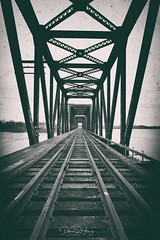 Trespass (Dan Haug) Tags: princeofwales bridge trespass trespassing ottawa ottawariver november bleak cloudy fall autumn abandoned leadinglines postprocessing xpro2 xf16mmf14rwr xf16mm fujixseries fujifilm mirrorless mirrorlesscamera