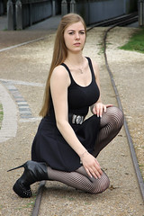 Denise 49 (The Booted Cat) Tags: sexy teen girl model black minidress fishnets fishnet pantyhose legs heels highheels boots booties