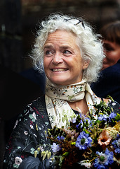 Flower girl. (D80_546838) (Itzick) Tags: candid copenhagen color colorportrait face facialexpression streetphotography smiling flowers whitehair scarf portrait denmark d800 itzick