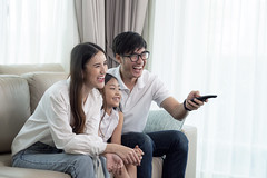 Asian family enjoy looking lcd tv on sofa in living room (I love landscape) Tags: fun television interior led screen smart kid lcd sofa livingroom room father mother mom dad remote enjoy house korean japanese chinese thai asia asian child family home people girl female man watching woman tv parent laughing sitting parenthood lifestyle food relatives eating control wife childhood lovely group together happiness relaxed