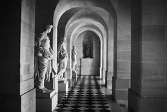 R3-063-30 (David Swift Photography) Tags: davidswiftphotography palaceofversailles versaillesfrance hallways statues sculptures archways historicbuildings france 35mm nikonfm2