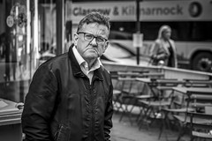 I Don't Like Mondays (Leanne Boulton) Tags: urban street candid portrait portraiture streetphotography candidstreetphotography candidportrait streetportrait streetlife eyecontact candideyecontact man male face eyes expression mood emotion feeling glasses mouth moody misery melancholy unhappy tone texture detail depthoffield bokeh naturallight outdoor light shade city scene human life living humanity society culture lifestyle people canon canon5dmkiii 70mm ef2470mmf28liiusm black white blackwhite bw mono blackandwhite monochrome glasgow scotland uk