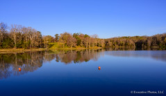 Blue Waters of Lake Fairfax (Evocative Photos) Tags: calm season woods reflection day lake background orange bluesky pond suburbs wideangle va facilities outdoors america horizontal spring buoys landscape bridge serene deepbluewaters water virginia usa tranquil rural light picturesque shore peaceful morning blue colorful scenery trees bright forest naturallight reston sky park nopeople fairfax countryside green