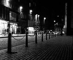 Edinburgh High Street (richardjholt) Tags: edinburgh night hasselblad ilford delta3200 film bw 6x6 120film 60mm
