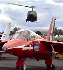 Huey Over Red (Fleet flyer) Tags: folland gnat t1 belluh1hghuey bell uh1h ghuey follandgnatt1 helicopter northweald