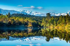 Mirror image reflections of the snow capped Southern Alps on Okarito Lagoon on the West Coast (stewart.watsonnz) Tags: lake nature water mountain sky pond landscape tree reflection outdoors wilderness mountainrange plant snow river forest cloud reservoir hill outdoor naturallandscape noperson wood scenery grass scenic background naturalenvironment waterresources standing naturereserve panoramic fall front peak barbaric tarn grazing travel biome covered lagoon composure atmosphericphenomenon land morning overlooking shoreline southern alps