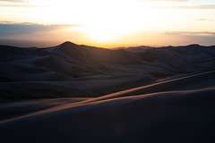 The Great Dunes at Sunset (virtualwayfarer) Tags: colorado unitedstatesofamerica crestone wild nature landscape outdoors nationalpark sand desert dunes dune greatsanddunes sanddunes naturephotography greatoutdoors landscapephotography usa southwest roadtrip aweinspiring protected pristine americansouthwest sonyalpha dramaticnature photographingamerica sonynordic a7riii sonyamericas travel abstract beautiful beauty shadows natural scenic windy windswept natgeo coloradorockies longlens singleexposure sunset rockies dusk continentaldivide latelight endofday travelphotographer alexberger