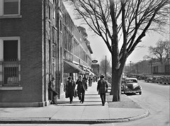 Just Off Main: Sidewalk traffic on main street on the day of tobacco auctions in Mebane, North Carolina. November 1939. (polkbritton) Tags: marionpostwolcott northcarolinahistory streetphotography 1930s fsaowi classiccars libraryofcongresscollections vintagefashion