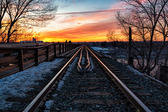 Sunset Tracks II (B.E.K. Photography) Tags: saskatoon saskatchewan canada train tracks bridge rails sunset clouds cpr winter trees snow evening river water blue white yellow orange red pink outdoor landscape nikond850 nikon1735f28 bek briankrouskie