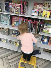 "Dani Picks a Book • <a style=""font-size:0.8em;"" href=""http://www.flickr.com/photos/109120354@N07/49052664752/"" target=""_blank"">View on Flickr</a>"