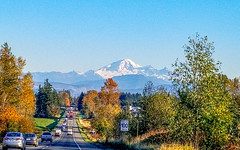 Mount Baker from Canada (darletts56) Tags: sky blue mountian mount baker usa canada highway road vehicle vehicles trees tree yellow orange red green gold golden grey white blues sign hill sunshine signs building buildings line wire power grass grasses
