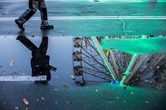 Street Reflections, Kyiv (Geraint Rowland Photography) Tags: walk walking realpeople candid streets streetphotography reflections composition nightlights neon wwwgeraintrowlandcouk bigwheel canon iso ferriswheel kontraktova podilinthehistoricalcenterofkyiv ukraine