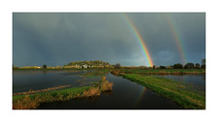 Le Mont Dol et l'arc en ciel (Loïc Gouyette) Tags: bretagne arc en ciel rainbow rain sun landscape paysage maraais reflexion reflection mont dol