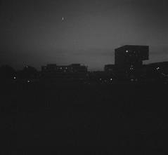 Evening on ISO 100 film (mkk707) Tags: film analog 35mmfilm zeissikontenaxii carlzeissjenatessar204cm agfaapx100 wwwmeinfilmlabde manualfocuslens germancameras rangefinder vintagelens vintagefilmcamera nightshot nightonearth nightonfilm moon blackwhite zeissikonstyle 24x24