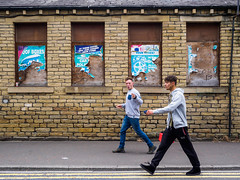 Brighouse 018 (Peter.Bartlett) Tags: eyecontact unitedkingdom people facade olympuspenf westyorkshire colour peterbartlett man urban candid uk m43 microfourthirds walking wall doubleyellowlines streetphotography men brighouse england
