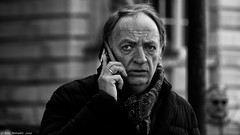 On Hold (Neil. Moralee) Tags: neilmoralee man mature old street candid wrinkles receeding hair look glance eye eyes telephone phone mobile call cell scarf cold liverpool neil moralee olympus omd em5 hold onhold waiting conversation technology black white mono monochrome blackandwhite blackwhite bw