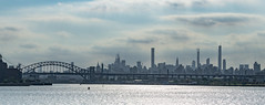 Approaching Gotham... (Aleem Yousaf) Tags: gotham new york nyc skyline east river bridge dark mood manhattan water rocks downtown boat transit 70200mm telephoto steel architecture nikon nikkor d850 modern building lights september 2019 skyscraper digital camera flickr travel apple big united states photography