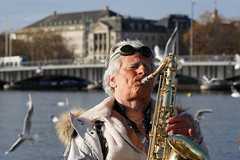 Can you feel it? (Honza 007) Tags: music live street zurich man saxophone bird birds bridge buildig water see river musician streetphotography streetview