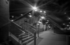 Station diffraction (OzzRod) Tags: sony a7rii 150lashesvsonye1 homemade bodycap pinhole night diffraction lights monochrome blackandwhite steps stairway station adamstown newcastle
