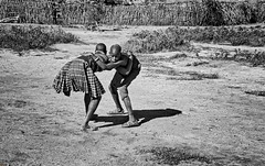 Art of Wrestling (Rod Waddington) Tags: africa african afrique afrika uganda ugandan karamoja karamojong tribe traditional tribal art wrestling girls village two culture cultural candid outdoor blackandwhite monochrome mono native