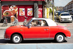 RED CAR , Balham hill , London (-- Carlosperez --) Tags: cars car red carros coches england style street picture canon photo foto pic sunny day nissan nissanfigaro