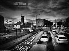 Welcome to Kings Dock (Neil. Moralee) Tags: neilmoralee liverpol dock street road cars traffic motor sky clouds dramatic dark reflection bus trip uk neil moralee olympus omd em5 car park buildings city cityscape urban contrast bmw ford citroen kings mersey merseyside scouse