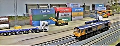 GBRf 66731 at Troutons Container Depot. (ManOfYorkshire) Tags: 66731 freight diesel gbrailfreight gbrf 176 scale oogauge troutons westyorkshire based container depot mainline spalding exhibition show exhibit 2019 class66 model railway train layout reachstacker lorry