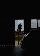 The Jumper (Stefan Waldeck) Tags: man car garage window door tiles building rooftops sky clouds reflections porto portugal 2019 netzki stefanwaldeck stefan waldeck