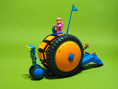 Riding the Techno Snail (David Roberts 01341) Tags: lego clockwork pullback windup motor toy minifigure space scifi snail mechanical orange technic