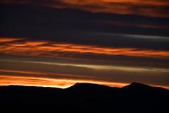 DSC_7404 (griecocathy) Tags: soleil ciel paysage lever orange jaune montagne gris noir bleu sombre nuage brun oranger crème lumineux