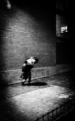 La vida es como caminar en la lluvia: o te escondes, o te mojas. (Elena m.d. 12.7M views.) Tags: street urban life monocromo nikon d5600 tokina 1116 2019 night shadows
