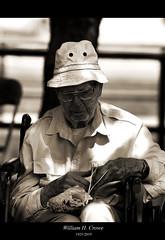 Tribute to Bill Crowe (Anthony Mark Images) Tags: billcrowe williamhcrowe queensuniversity gulfoilengineer un father grandfather greatgrandfather people portrait nikon d300 blackandwhite sepia parkwoodmennonitehome waterloo ontario canada wheelchair bagofpopcorn whiteshirt whitehat glasses senior