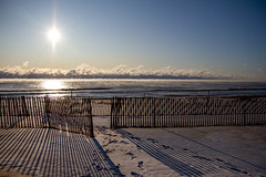 Sunrise (Lester Public Library) Tags: neshotahbeach neshotah neshotahpark beach beaches sunrise clouds fence lakemichigan lake water snow wisconsin greatlakes tworiverswisconsin tworivers lesterpubliclibrarytworiverswisconsin readdiscoverconnectenrich
