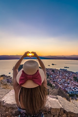 Don't let the sun go down (Vagelis Pikoulas) Tags: sun sunset view nafplio greece sunburst woman girl hat tokina 1628mm summer august 2019 europe greek sky architecture city cityscape