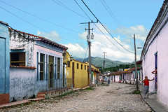 Between Neighbors (emerge13) Tags: architecture colonialarchitecture cuba trinidadsanctispirituscuba architecturaldetails humans candid cobblestonestreets trinidad street streets trinidadcuba colorfulcities livingstreets perspective