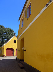 Yellow building with red trim in Saeby, Denmark (albatz) Tags: yellow wall building red trim saeby denmark