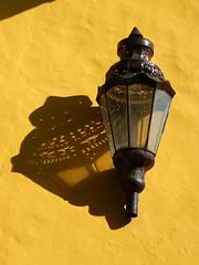 Yellow wall with a lantern and its shadow in Puebla, Mexico (albatz) Tags: yellow wall shadow puebla mexico lantern