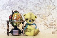 button does not like globes (rockinmonique) Tags: button teddybear bear tinybear globe macro miniature yellow moniquewphotography canon canont6s tamron tamron45mm copyright2019moniquewphotography