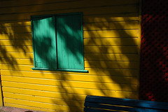 Yellow wall with turquoise shutters in La Boca, Buenos Aires, Argentina (albatz) Tags: bright yellow laboca buenosaires argentina wall