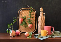 From the Orchard (Esther Spektor - Thanks for 16+millions views..) Tags: stilllife naturemorte bodegon naturezamorta stilleben naturamorta art creativephotography composition tabletop autumn food fruit pomegranate crop branch tray bottle cup napkin leaf wicker cramics linen wooden ambientlight green yellow red pink beige brown black estherspektor canon