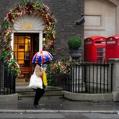 The Mayfair Flare (DobingDesign) Tags: streetphotography umbrella unionjackflag lights tones doorway mayfair london londonstreets shopping rainy raining railings door traditional stereotypical citylife lighting
