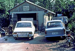 Dacia 1300 and  Trabant at a home garage  Balantanmadi   Hungary July 4 1978 (D70) Tags: dacia 1300 trabant home garage balantanmadi hungary july 4 1978 fzuiko autos 38mm f18 film slide kodachrome 64 halfframe cars olympus penf káptalanfüred veszprémmegye july4