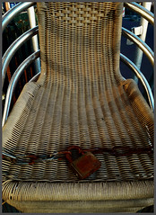 If it was God's intention that we walk around naked, He would never have invented wicker chairs. (~Ingeborg~) Tags: meinge amsterdam rozengracht lijnbaansgracht barbrandstof chairs stacked seasonalmostover chained lock endoftheday withmarissa yin phone harmony details