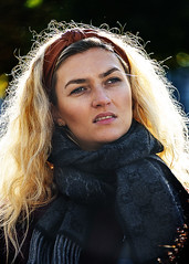 Portrait (D80_547181) (Itzick) Tags: candid copenhagen color colorportrait blonde blackbackground backlight youngwoman streetphotography scarf face facialexpression denmark d800 itzick