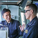 Rear Adm. Hiroshi Egawa meets with U.S. Navy Commodore Steven DeMoss on the bridge of a JMSDF ship underway in formation during Annual Exercise 19.