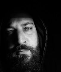 Self-Portrait (FraConti84) Tags: bw bnwshot blackandwhite bnwpeople bnwmood bnwportrait blackandwhiteportrait blackandwhitepeople autoritratto highcontrast peopleinblackandwhite myself selfportrait hood beard